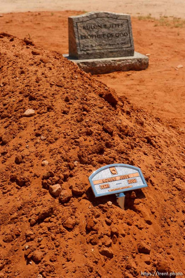 "Colorado City - A mound of dirt and small placard mark Norene Jeffs' simple grave, next to that of Rulon Jeffs, her husband. Friends and family members of Norene Jeffs gathered in the Colorado City cemetery to remember this plural wife, who had been buried the previous week in a secret funeral by members of the Fundamentalist Church of Jesus Chris of Latter-Day Saints (FLDS). Jeffs, who had been ""sealed"" to the previous FLDS prophet Rulon Jeffs (Warren Jeffs' father), was buried even before family members exiled from the secretive church were notified of her death."