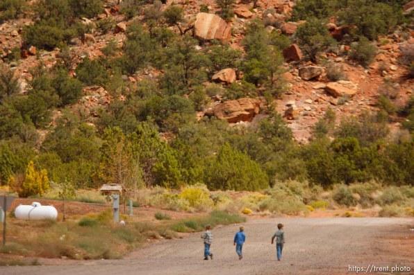 boys walking gravel roads