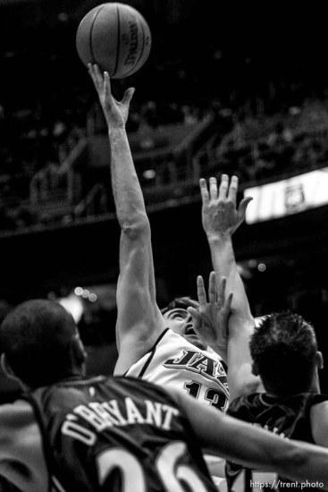 Salt Lake City - Utah Jazz center Mehmet Okur (13) scores two with Golden State Warriors center Patrick O'Bryant (26) and Golden State Warriors forward Andris Biedrins (15) defending. Utah Jazz vs. Golden State Warriors, NBA basketball Saturday night at EnergySolutions Arena.