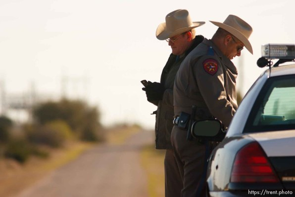 """Eldorado - Texas State Troopers Sgt. Stan Waters (left) and Martin Molotsky manning a roadblock on road CR-300, which leads to the FLDS YFZ """"Yearning for Zion"""" compound outside of Eldorado, Texas, Saturday, April 5, 2008."""