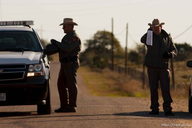 """Eldorado - Texas State Troopers Sgt. Stan Waters (fur collar) and Martin Molotsky manning a roadblock on road CR-300, which leads to the FLDS YFZ """"Yearning for Zion"""" compound outside of Eldorado, Texas, Saturday, April 5, 2008."""
