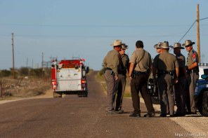 """Eldorado - Texas State Troopers at a roadblock on road CR-300, which leads to the FLDS YFZ """"Yearning for Zion"""" compound outside of Eldorado, Texas, Saturday, April 5, 2008, just before the temple was breached."""