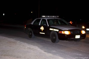 Eldorado - Official vehicles on CR-300 the night Texas law enforcement breaches and searches the building on the YFZ Ranch outside of Eldorado, Texas. 04.05.2008