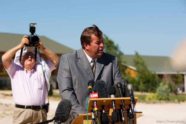 Eldorado - FLDS spokesman Willie Jessop read a statement from the FLDS Church at the YFZ ranch Monday, June 2, 2008. The statement said the sect would not allow underage marriages.. Monday June 2, 2008. AP photographer with towel on his head and pink shirt