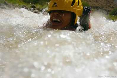 Kayaking at butler wash. maggie thach swimming the rapid