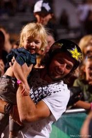 Salt Lake City - Mike Aitken high-fives his 1-year-old son Owen, BMX Dirt, AST Dew Tour, Friday September 12, 2008.