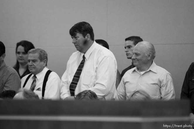 Trent Nelson | The Salt Lake Tribune In the gallery, people stand to show honor and respect to Warren Jeffs, leader of the FLDS Church, appeared before Judge Terry Christiansen in Third District Court Tuesday, September 7, 2010 in West Jordan, Utah. merril jessop, willie jessop