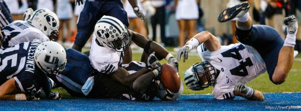 Trent Nelson | The Salt Lake Tribune Utah State's Derrvin Speight runs the ball during the first half. Speight was ruled down on the one-yard line. BYU linebacker Brandon Ogletree (44) at right. Utah State vs. BYU college football in Logan Friday, October 1, 2010.