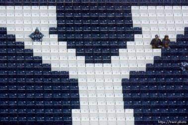 Trent Nelson | The Salt Lake Tribune BYU football fans sit in the rain awaiting the start of the BYU vs. Wyoming college football game Saturday, October 23, 2010 at LaVell Edwards Stadium in Provo.