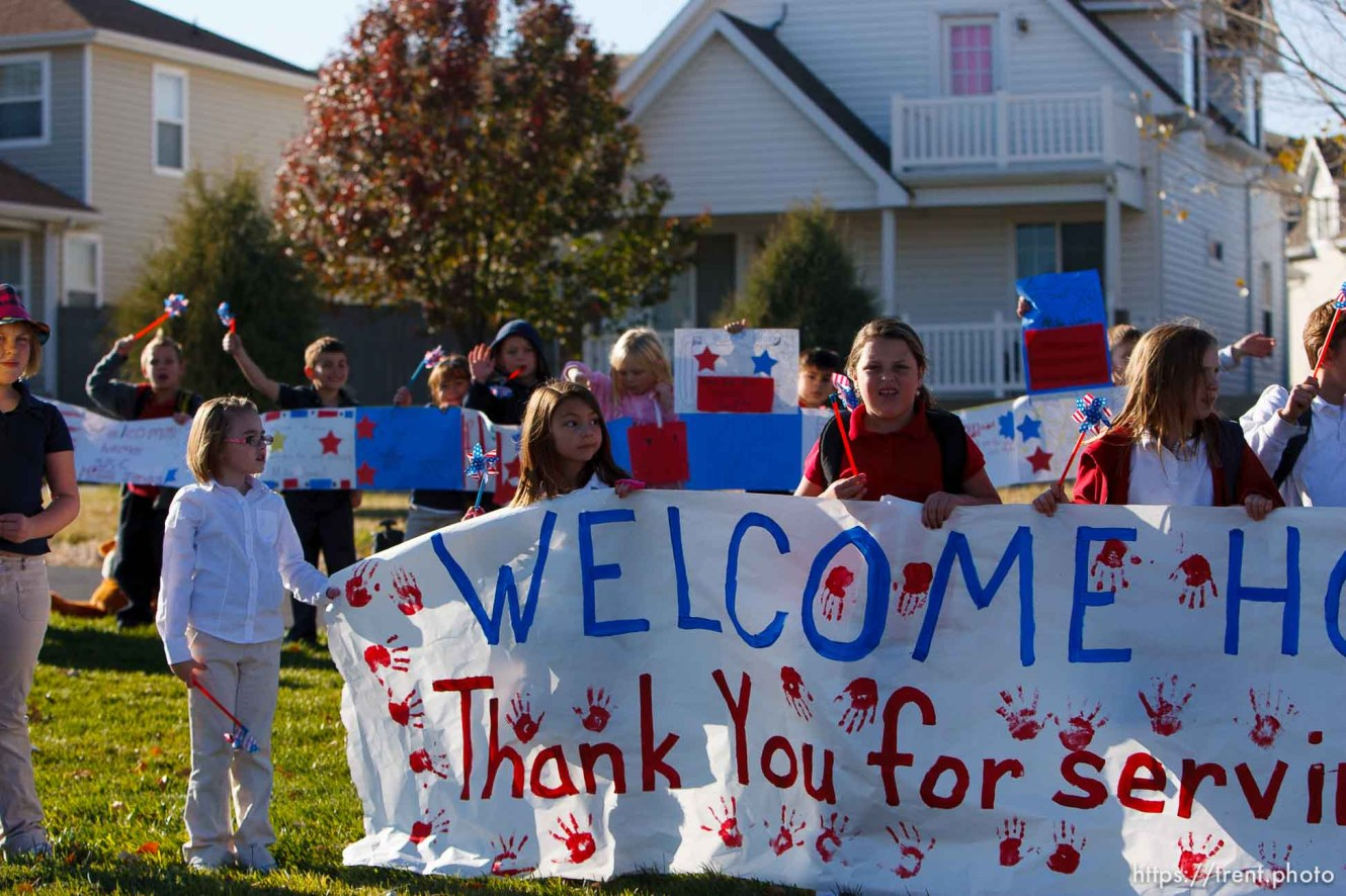 Trent Nelson | The Salt Lake Tribune SFC Mike Jones, Utah National Guard, was welcomed home to Eagle Mountain by family, friends and neighbors who lined the streets of Eagle Mountain Friday, November 12, 2010. On his fourth deployment, Jones was injured in Afghanistan in September.