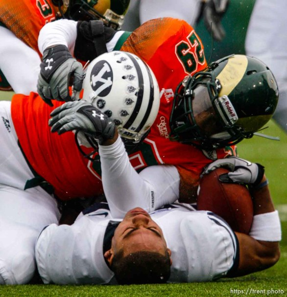 Trent Nelson   The Salt Lake Tribune Colorado State's Broderick Sargent pulls the helmet off BYU running back Joshua Quezada (20) during the second half. BYU vs. Colorado State, college football, Saturday, November 13, 2010. BYU won 49-10.