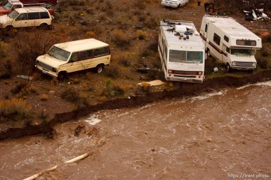 Trent Nelson | The Salt Lake Tribune Recreational vehicles in a precarious position on the edge of Beaver Dam Wash in Motoqua, Utah, Wednesday, December 22, 2010.