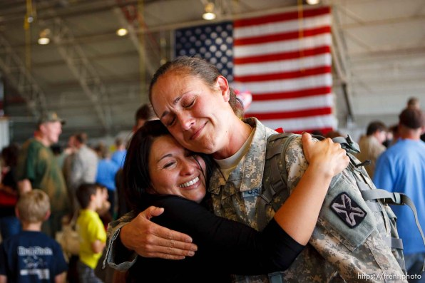 Trent Nelson | The Salt Lake Tribune Spc Lisa Bradford, right, embraces Sgt Fresia Alder as the Utah National Guard's 141st Military Intelligence Battalion returned to Salt Lake City, Utah, from duty in Iraq Wednesday, June 15, 2011. The two served together in Iraq. Some 275 soldiers of the 141st deployed in June last year.