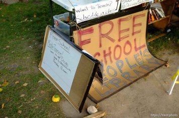 free school and media training signs, at Occupy Salt Lake, in Salt Lake City, Utah, Wednesday, October 26, 2011.