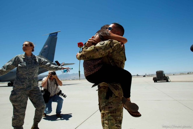 Trent Nelson | The Salt Lake Tribune A soldier gets a tight embrace as the soldiers from the Utah Army National Guard's Second Battalion, 211th Aviation unit returned from a 12-month deployment to Afghanistan, Saturday, June 23, 2012 in Salt Lake City, Utah. tom smart