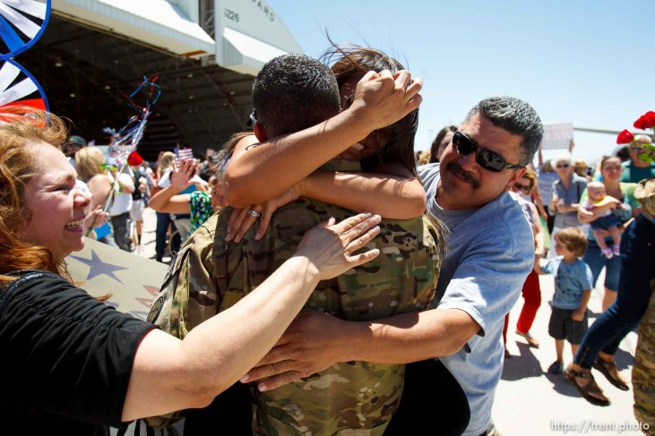 Trent Nelson | The Salt Lake Tribune A soldier gets a tight embrace as the soldiers from the Utah Army National Guard's Second Battalion, 211th Aviation unit returned from a 12-month deployment to Afghanistan, Saturday, June 23, 2012 in Salt Lake City, Utah.