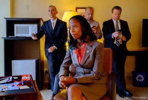 Trent Nelson | The Salt Lake Tribune Utah Congressional candidate Mia Love, answers interview questions at the Sheraton Hotel in Tampa, Florida, Monday, August 27, 2012, the day before the Republican National Convention kicks off. At rear, left to right, are Love's husband Jason Love and campaign staffers Steve Hunter and Boyd Matheson.