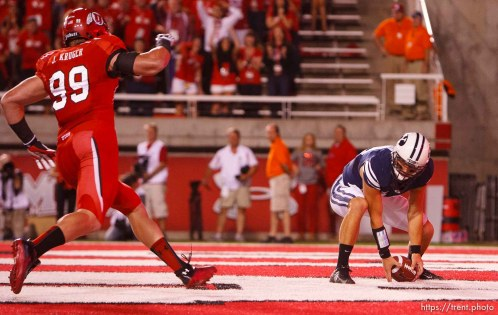Trent Nelson | The Salt Lake Tribune Utah defensive end Joe Kruger (99) tackles Brigham Young quarterback Riley Nelson (13) in the end zone for a safety, but is called for a face mask penalty, as Utah hosts BYU college football in Salt Lake City, Utah, Saturday, September 15, 2012.