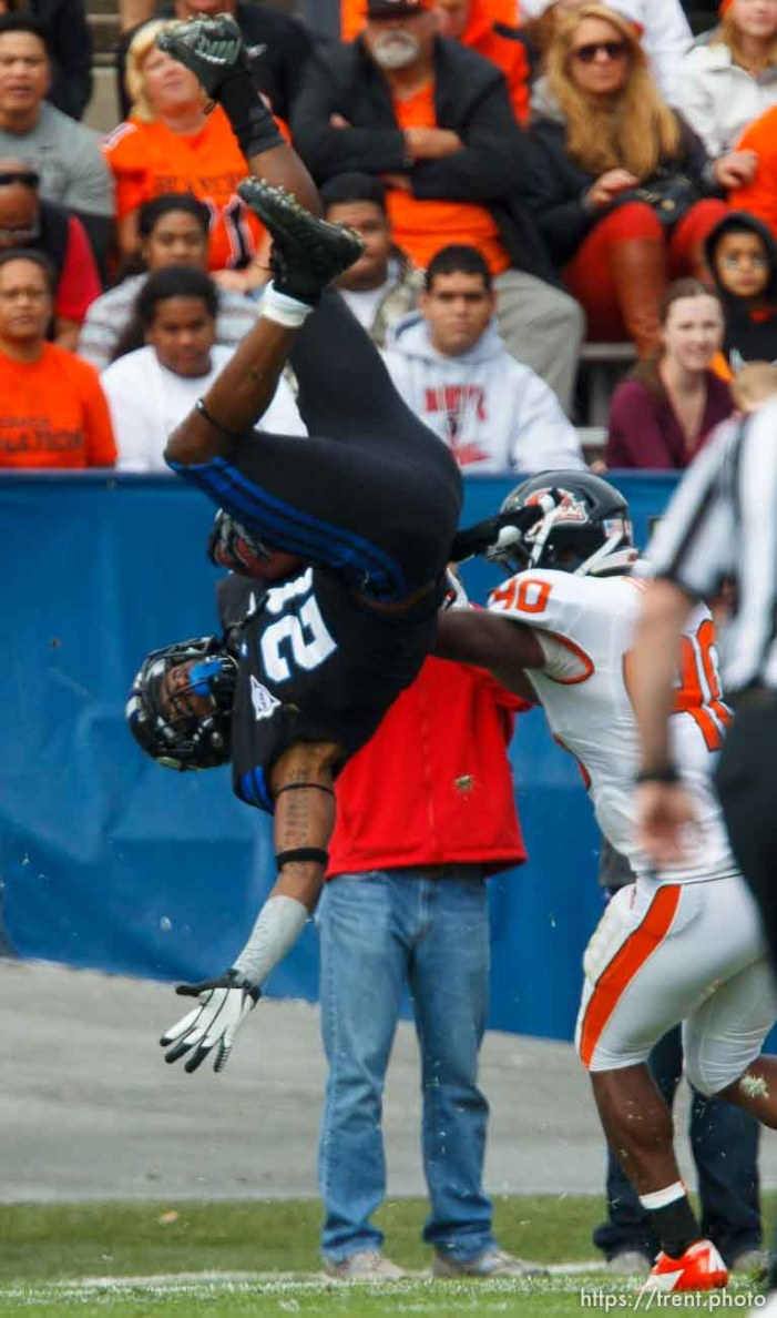 Trent Nelson   The Salt Lake Tribune BYU's Jamaal Williams flips in the first quarter as BYU hosts Oregon State college football Saturday October 13, 2012 in Provo, Utah. Oregon State's Michael Doctor defending.