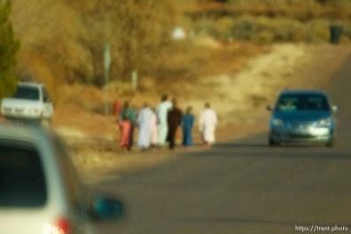 women walking, blurred through windshield, Thursday November 29, 2012.