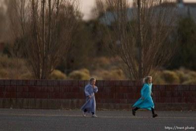 girls running in LSJ parking lot, Thursday November 29, 2012.