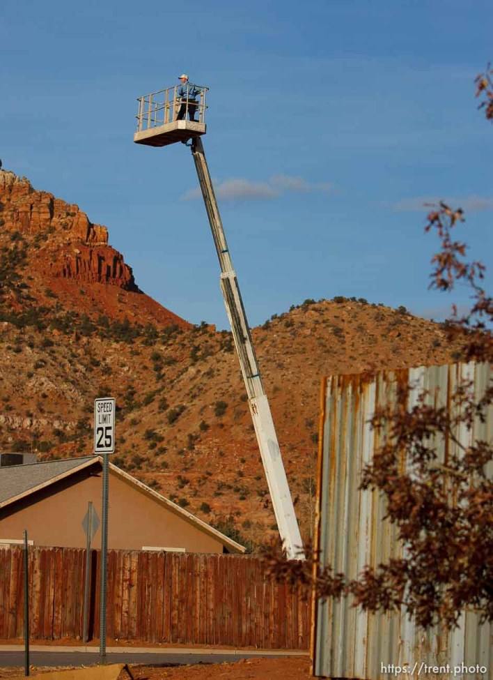Trent Nelson   The Salt Lake Tribune A young boy on a cherry picker Thursday November 29, 2012 in Hildale.