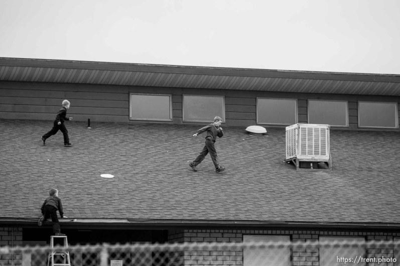 Trent Nelson | The Salt Lake Tribune boys running on roof of school Friday November 30, 2012 in Colorado City.
