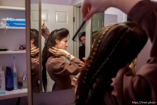 Trent Nelson | The Salt Lake Tribune Heidi Holm does her hair Saturday December 1, 2012 in Colorado City. Holm and her sister Helen (at rear) recently left the FLDS church.