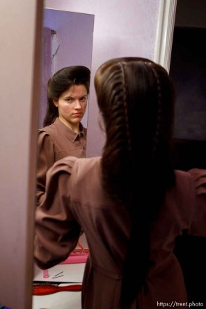 Trent Nelson | The Salt Lake Tribune Heidi Holm does her hair Saturday December 1, 2012 in Colorado City. Holm and her sister Helen recently left the FLDS church.
