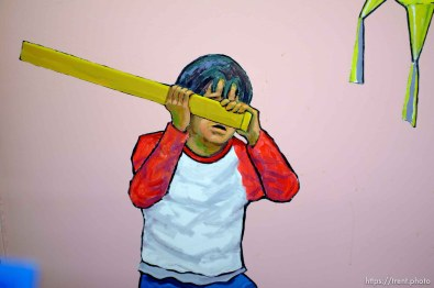 painting of boy hitting piñata, Wednesday December 12, 2012