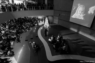 Trent Nelson | The Salt Lake Tribune Attendees watch a slide show during a public memorial for Emilie Parker at Ben Lomond High School in Ogden, Thursday December 20, 2012. Parker was killed in the Sandy Hook Elementary School shooting.
