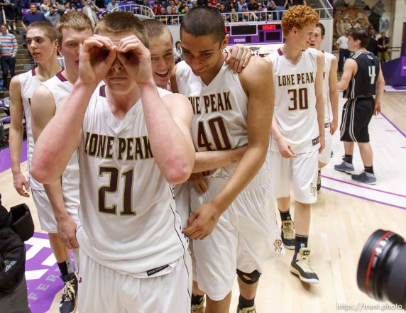 Lone Peak's Talon Shumway signals to photographers after beating Alta High School in the 5A basketball state championship game Saturday, March 2, 2013 in Ogden.