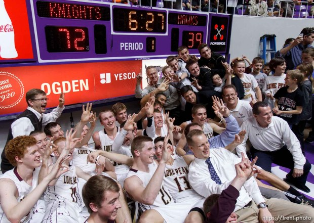 Lone Peak poses for a team photo under the scoreboard after beating Alta High School in the 5A basketball state championship game Saturday, March 2, 2013 in Ogden.