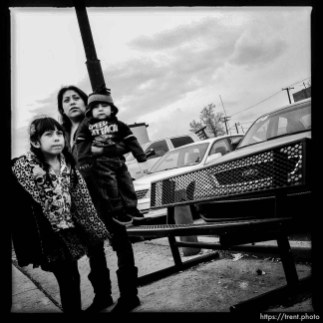 mom and kids at bus stop. south state project.