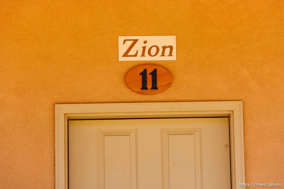 "Trent Nelson | The Salt Lake Tribune A sign reads, ""Zion"" over the front door of an apartment in Hildale, Friday April 26, 2013. The property was purchased by Willie Jessop who spent the day allowing former followers to see the inside of a compound they had previously not been allowed to enter."