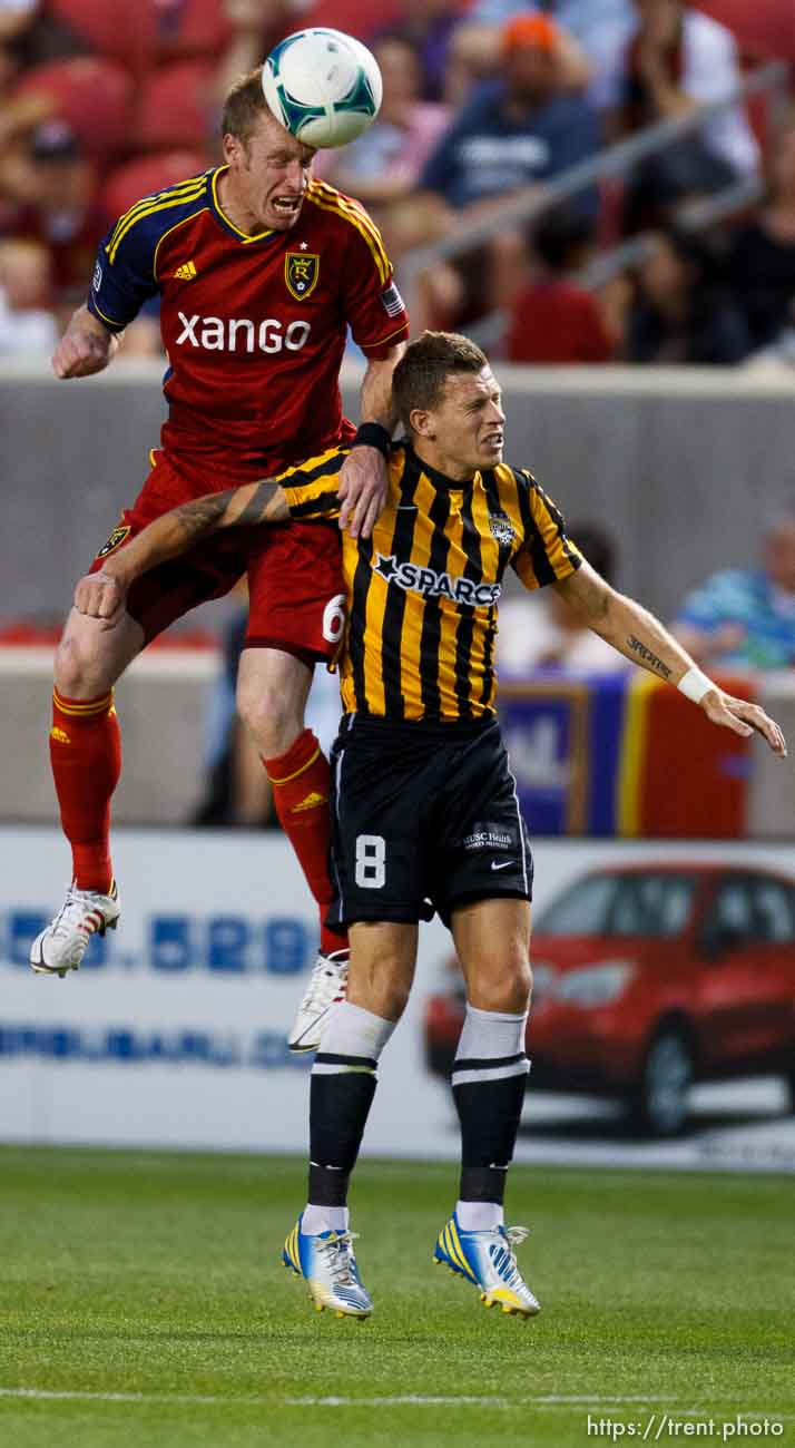 Trent Nelson | The Salt Lake Tribune Real Salt Lake's Nat Borchers leaps over Charleston's Nicki Paterson as Real Salt Lake hosts Charleston Battery in the US Open Cup Wednesday June 12, 2013 at Rio Tinto Stadium in Sandy, Utah.