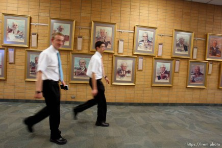 Trent Nelson | The Salt Lake Tribune Missionaries walk past portraits of church leaders at the Missionary Training Center of the Church of Jesus Christ of Latter-day Saints in Provo Tuesday June 18, 2013.