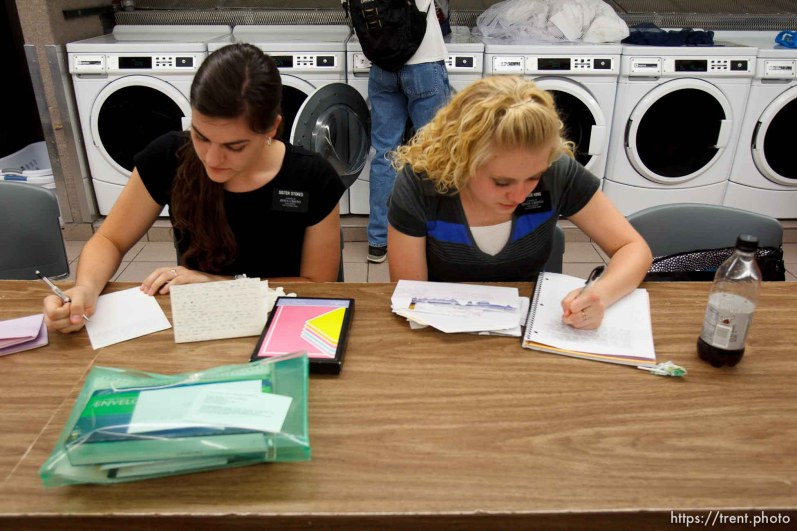 Trent Nelson | The Salt Lake Tribune Missionaries Amanda Stokes and Holly King write letters home while doing laundry at the Missionary Training Center of the Church of Jesus Christ of Latter-day Saints in Provo Tuesday June 18, 2013.