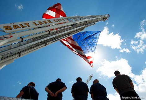 Trent Nelson | The Salt Lake Tribune Flags fly as the funeral procession for Sgt. Derek Johnson, the Draper police officer who was shot to death on Sunday morning, passes through Draper Friday, September 6, 2013.