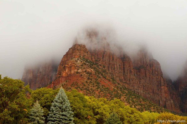Trent Nelson | The Salt Lake Tribune fog over el capitan, vermillion cliffs, from maxwell park in Hildale Thursday, October 10, 2013.