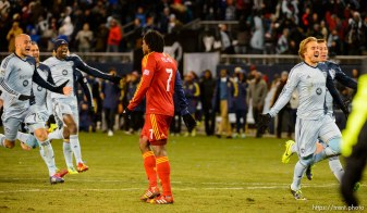 Trent Nelson | The Salt Lake Tribune Sporting KC players celebrate, running past Real Salt Lake's Lovel Palmer (7) as Real Salt Lake faces Sporting KC in the MLS Cup Final at Sporting Park in Kansas City, Saturday December 7, 2013.