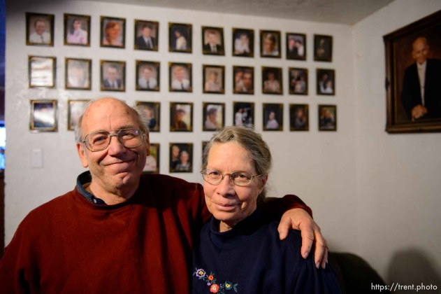 Trent Nelson   The Salt Lake Tribune Marvin and Charlette Wyler in their Hildale home, Saturday December 14, 2013. On the wall behind them are portraits of Marvin's 34 children, and polygamist leader Leroy Johnson.