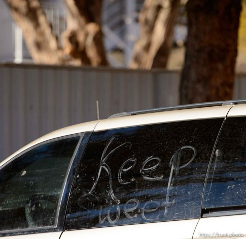 Trent Nelson | The Salt Lake Tribune Keep Sweet, a common FLDS phrase, written on a van in Hildale Sunday December 15, 2013.