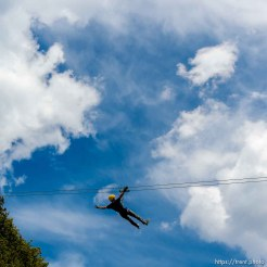 Trent Nelson | The Salt Lake Tribune A rider in flight at Max Zipline, in Provo Canyon, Saturday May 31, 2014.