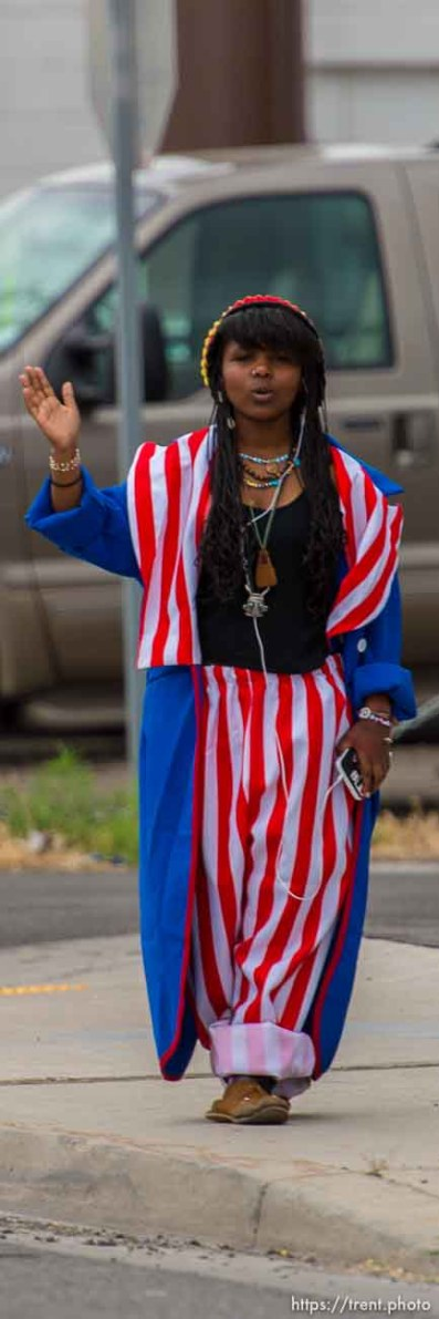 woman in red white and blue waving, state street, Monday, June 16, 2014.