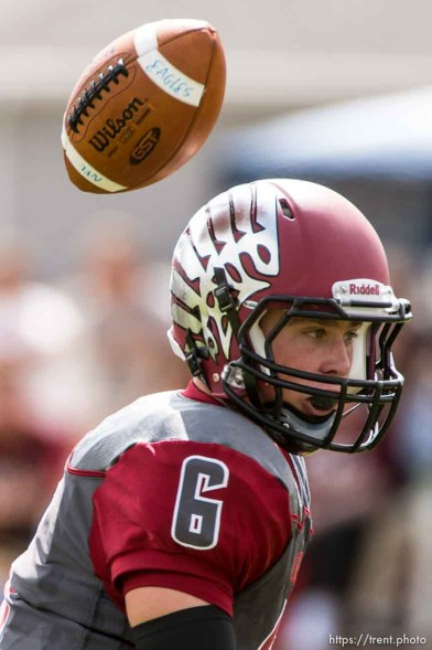 Trent Nelson | The Salt Lake Tribune Layton Christian quarterback Grayson Jackson loses a high snap while facing Duchesne, high school football in Layton Thursday August 21, 2014.