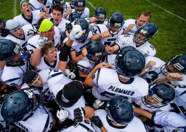 Trent Nelson | The Salt Lake Tribune Duchesne huddles pre-game before facing Layton Christian Academy, high school football in Layton Thursday August 21, 2014.