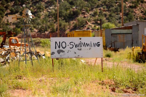 Trent Nelson | The Salt Lake Tribune no swimming sign in Hildale, Thursday September 25, 2014.