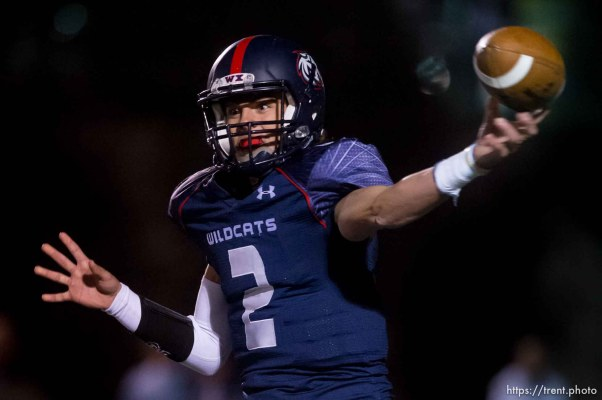 Trent Nelson | The Salt Lake Tribune Woods Cross quarterback Tanner Hammond throws the ball as Woods Cross hosts Corner Canyon High School football, in Woods Cross, Wednesday October 15, 2014.