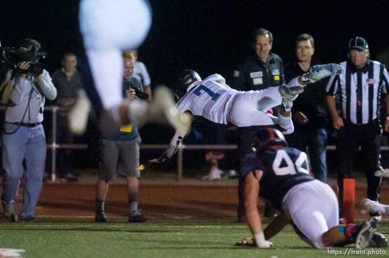 Trent Nelson | The Salt Lake Tribune Corner Canyon quarterback Michael Ebeling dives into the end zone for a two-point conversion and the win over Woods Cross High School football, in Woods Cross, Wednesday October 15, 2014.